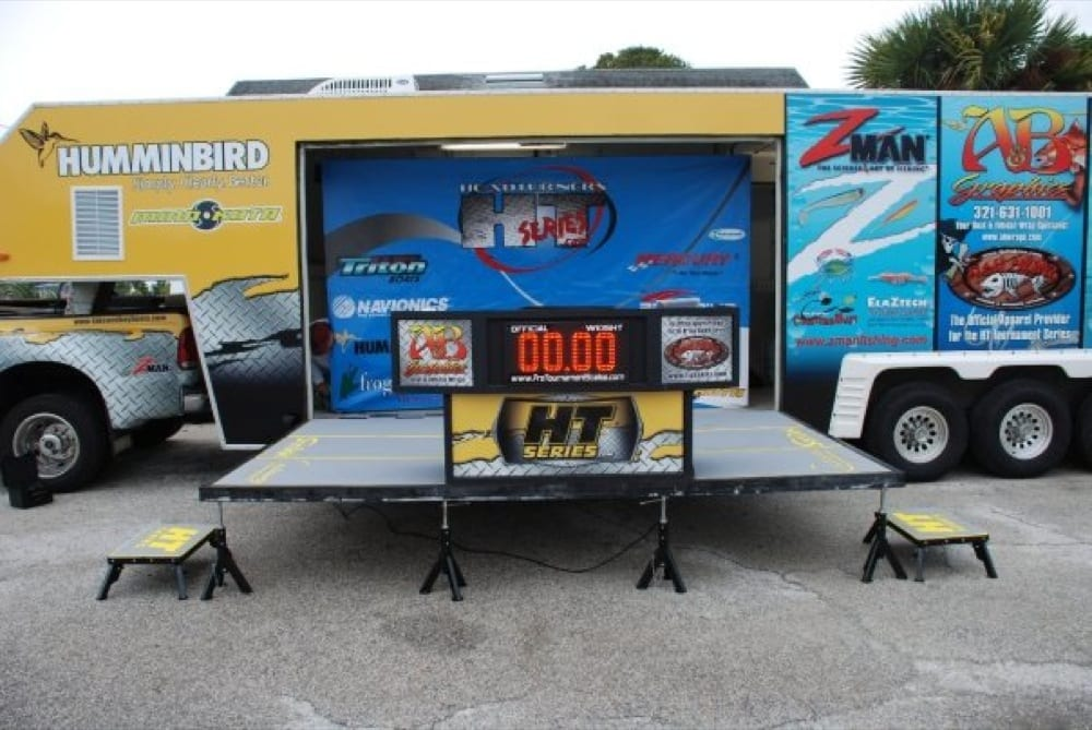 The trailer rig with the foldout stage and weighin table setup